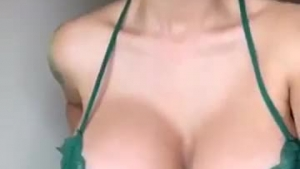 Kinky, red haired woman in green dress is wet behind the walls and wants to get facial cumshots