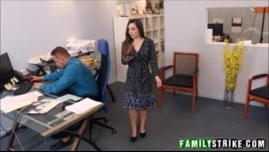 Sexy, tattooed brunette with big tits is sucking cock at work and getting her ass fingered